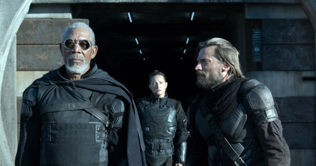 "Beech (Morgan Freeman, left) gives orders to Kara (Zoe Bell, center) and Sykes (Nikolaj Koster-Waldau) in ""Oblivion,"" an original and groundbreaking cinematic event from the visionary director of ""TRON: Legacy""and producers of ""Rise of the Planet of the Apes."" (Courtesy Universal Pictures/MCT)"