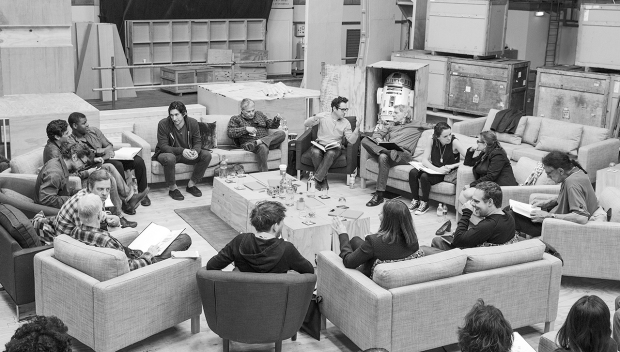 April 29th, Pinewood Studios, UK - Writer/Director/Producer J.J Abrams (top center right) at the cast read-through of Star Wars Episode VII at Pinewood Studios with (clockwise from right) Harrison Ford, Daisy Ridley, Carrie Fisher, Peter Mayhew, Producer Bryan Burk, Lucasfilm President and Producer Kathleen Kennedy, Domhnall Gleeson, Anthony Daniels, Mark Hamill, Andy Serkis, Oscar Isaac, John Boyega, Adam Driver and Writer Lawrence Kasdan. Copyright and Photo Credit: David James.