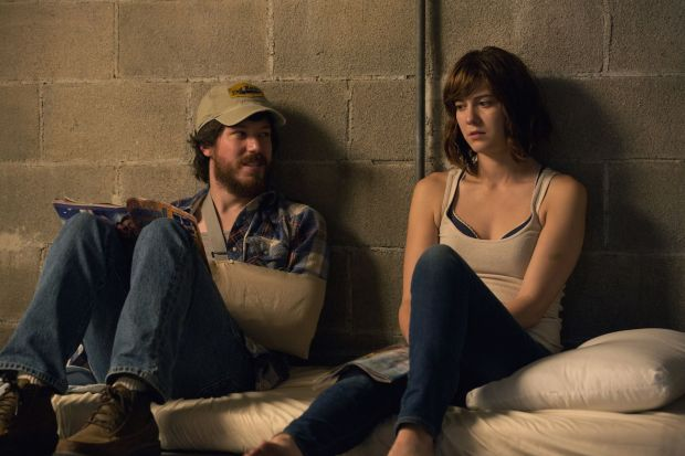 John Gallagher Jr. as Emmett, Mary Elizabeth Winstead as Michelle in 10 CLOVERFIELD LANE, by Paramount Pictures